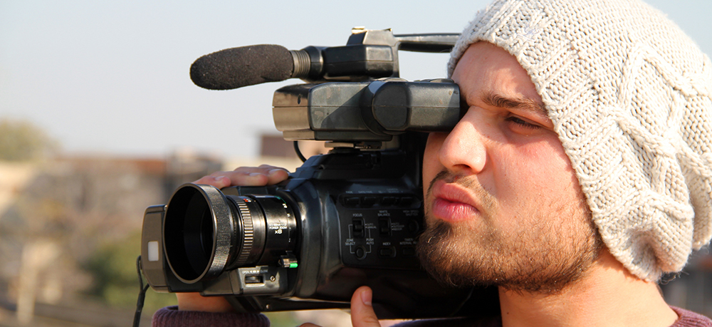 Opinion: Why I Regret Film School: Student Holding Old Tape Camera