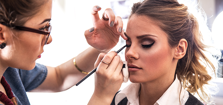 How to Apply Camera-Friendly Makeup for Men and Women: Woman Applying Makeup