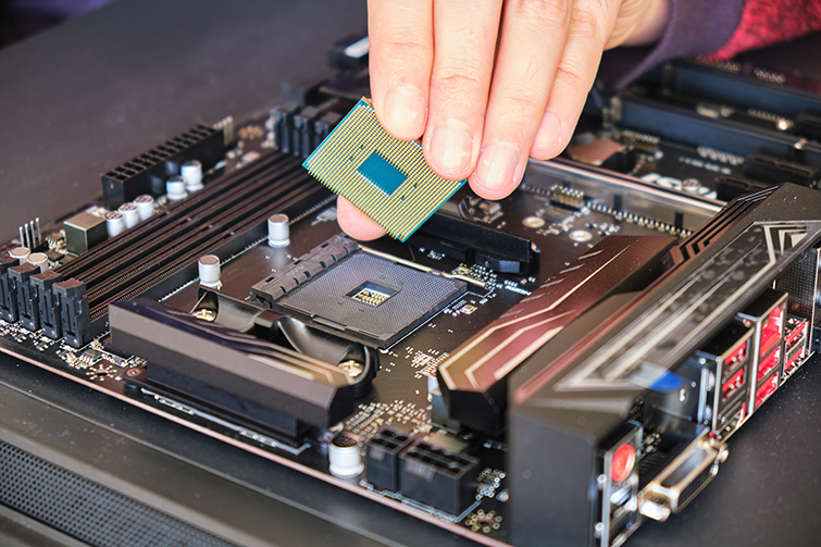 Placing a Computer Chip on a Motherboard