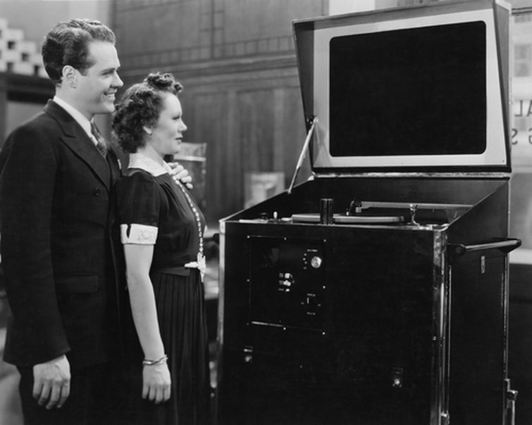 A Couple Viewing a TV