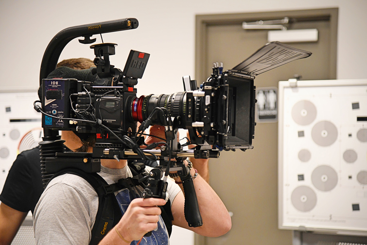 Videographer using RED cinema camera
