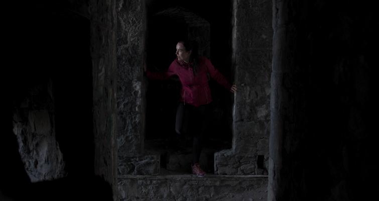 Woman Exploring Castle